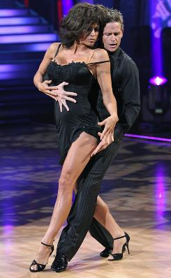 Dancing to the top: Pamela Anderson, Damian Whitewood of Dancing With the Stars, which was network TV's top-rated show last week.