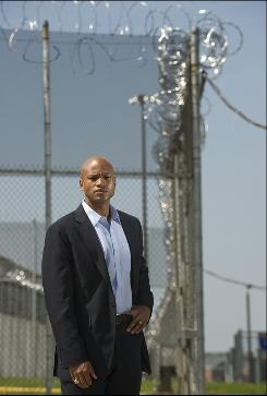 Author Wes Moore stands outside the fence at the Jessup Correctional Institution in Maryland, where the other Wes Moore is imprisoned.