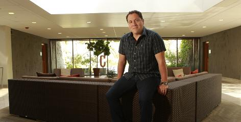 Bare walls, full mind: Jon Favreau, the director of Iron Man 2, relaxes at his office in Santa Monica, Calif. The highly anticipated sequel hits theaters today.