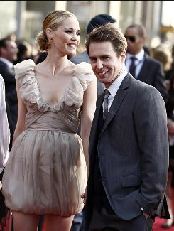 Sam Rockwell and girlfriend Leslie Bibb arrive at the premiere of Iron Man 2 in Los Angeles last week. Rockwell plays a villainous arms dealer, while Bibb reprises her role as a journalist.