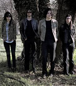Weather men, and woman: Alison Mosshart, left, Dean Fertita, Jack White, Jack Lawrence.