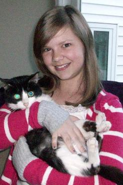 Hannah Blaze, with Molly, one of her two cats, was a grand prize winner in this year's Kindest Kids competition conducted by the American Humane Association. She won for her efforts to improve conditions at her Ohio animal shelter.