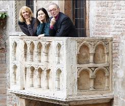 """Three of Juliet's """"secretaries,"""" Giovanna Tamassia, left, Elena Marchi, and Giulio Tamassia on the balcony of Juliet's house in Verona, Italy, which dates to the 13th century but was renovated in the 20th century."""