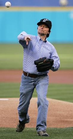 Documentarian Ken Burns, a big baseball fan, throws out the first pitch at a Marlins/Braves game.