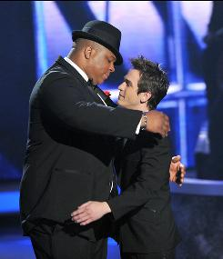On American Idol, Michael Lynche, left, says goodbye to Aaron Kelly, who had a bad week  as did the show's ratings.
