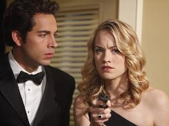 Zachary Levi as Chuck Bartowski and Yvonne Strahovski co-stars as Sarah Walker in Chuck.