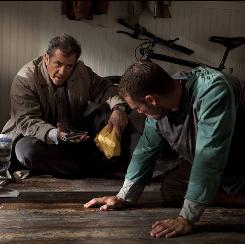Mel Gibson and Shawn Roberts star in Edge of Darkness, which is based on a 1985 BBC minseries.