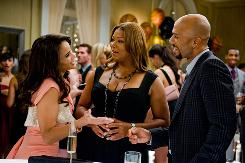 Morgan (Paula Patton), left, shoves her friend Leslie Wright (Queen Latifah) out of the way to get a shot at an NBA star (Common).