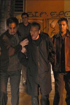 Real-time adventures: CTU agent Jack Bauer (Kiefer Sutherland, center) puts his life in danger to help find the terrorists in the episode that covered Day 4, 8-9 p.m.