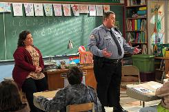 Officer Biggs (Billy Gardell) and Miss Flynn (Melissa McCarthy) find love at an Overeaters Anonymous meeting in CBS' new sitcom Mike and Molly.