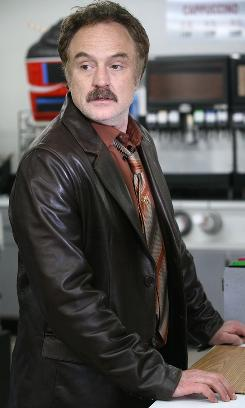 As officer Dan Stark, Bradley Whitford (and his 'stache) goes after the bad guys in Good Guys.