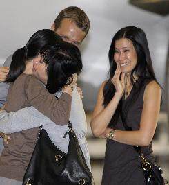This was the scene last August when Laura Ling, left, reunited with her mother, Mary, husband Iain Clayton and sister Lisa following her release from nearly five months in captivity in North Korea