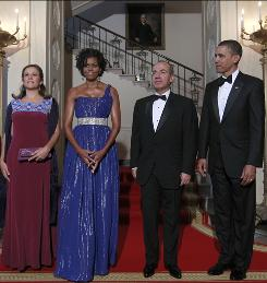 Guests of honor: Mexican first lady Margarita Zavala, Michelle Obama, Mexican President Felipe Calderon and President Obama have a photo op at the Grand Staircase before entering the state dinner.