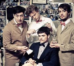 Mumford & Sons : Marcus Mumford, left, Ted Dwane, Marshall Winston (sitting) and Ben Lovett.