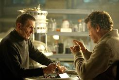 Walter (John Noble, right) reunites with his former lab partner, William Bell (Leonard Nimoy) in the alternate universe.