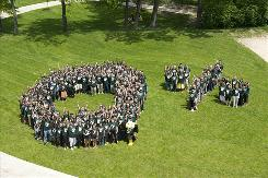Participants at a campus picnic in Ypsilanti celebrate a tuition freeze at Eastern Michigan University with a big fat zero and a percent sign.