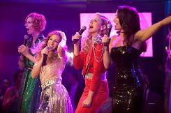 Miranda Hobbes (Cynthia Nixon), left, Carrie Bradshaw (Sarah Jessica Parker), Samantha Jones (Kim Cattrall) and Charlotte York (Kristin Davis) are women, hear them roar.