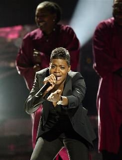 Fantasia Barrino performs I Believe upon winning Season 3 of American Idol in May 2004,