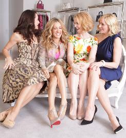 You better shop around: Kristin Davis, left, Sarah Jessica Parker, Cynthia Nixon and Kim Cattrall hit New York City's Bergdorf Goodman department store in March to promote Sex and the City 2, which opens nationwide today.