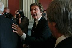 Paul McCartney jokes with the crowd at the Library of Congress on Tuesday.
