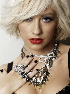 Singer Christina Aguilera is out with a new CD that, once she moves beyond naughtiness, shows her maturity as an artist.