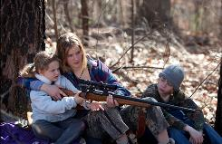 Teenager Ree (Jennifer Lawrence) must protect her younger siblings, played by Ashlee Thompson and Isaiah Stone.