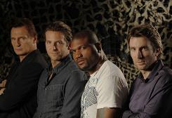 Team photo: Liam Neeson, left, Bradley Cooper, Quinton &quot;Rampage&quot; Jackson and Sharlto Copley star in The A-Team. 