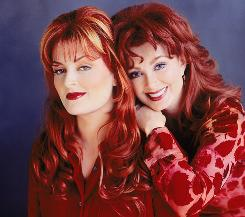 Wynonna, left, and her mother Naomi Judd will reunite for the first time in 10 years for an 18-city tour.