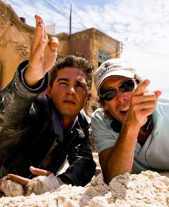 At work: Shia LaBeouf, left, and Michael Bay on the set of 2009's Transformers: Revenge of the Fallen. Both will return for the sequel.