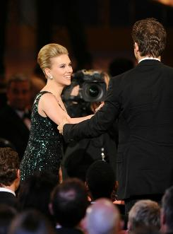 A winner's glow: Scarlett Johansson, best featured actress in a play, is congratulated by her husband, Ryan Reynolds.