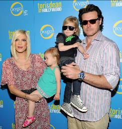 """We thought we had the perfect relationship"": But even reality stars Tori Spelling (holding daughter Stella) and Dean McDermott (holding son Liam) had some marital problems last year."