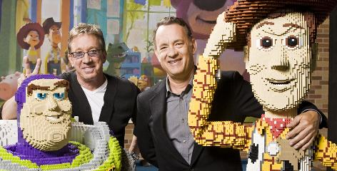 Buddy story: Tim Allen, left, and Tom Hanks hang out with their Lego alter egos, Buzz Lightyear and Woody, at Pixar studios in Emeryville, Calif.