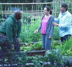 Culinary intervention: John Besh, right, discusses herbs with Gina Giangrosso and Bobbi Jordan on TLC's Inedible to Incredible. 