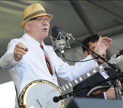 On a different stage: Steve Martin performs with the Steep Canyon Rangers at the New Orleans Jazz & Heritage Festival in April. He's been touring with the band since meeting its members at a party last year.