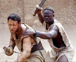 Djimon Hounsou, right, has Russell Crowe's back in CGI Rome. Gladiator paved the way for 300  and Prince of Persia.