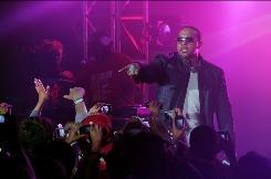 Rapper-producer Timbaland performs at a graduation party for students at Culver City High School in Culver City, Calif. Wednesday night.