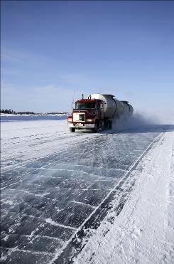 Danger ahead: A truck makes the treacherous journey across an ice road in a scene from The History Channel's Ice Road Truckers.