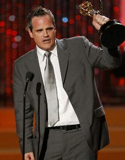 As the World Turns' Michael Park accepts the Daytme Emmy outstanding lead actor in a drama series Sunday in Las Vegas. The long-running soap opera will not be returning this fall.