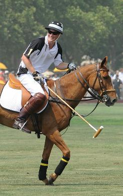 Giddyap: Prince Harry rides forth in Sunday's Veuve Cliquot Polo Classic on Governors Island.