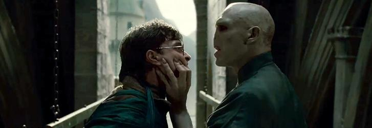 Wizard Harry Potter (Daniel Radcliffe), left, and Lord Voldemort (Ralph Fiennes) have a showdown in Harry Potter and the Deathly Hallows, Part 1.