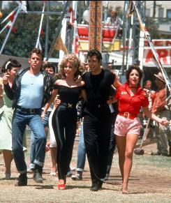 They go together to theaters: Jeff Conaway, left, Olivia Newton-John, John Travolta, Stockard Channing and the gang will hit 12 markets Thursday in Grease: Sing-A-Long.