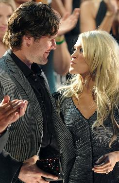 Mike Fisher with Carrie Underwood after she won an award at the CMT Music Awards.