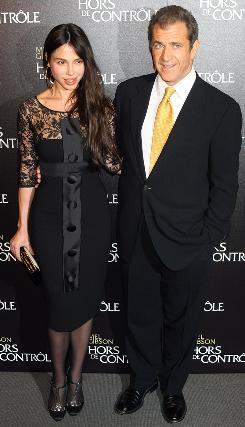 In February: Mel Gibson and Oksana Grigorieva arrive at the Paris premiere of his movie Edge Of Darkness.