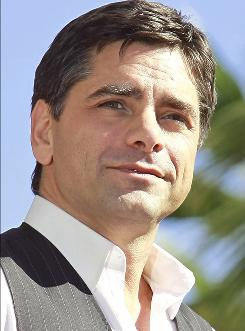 John Stamos claims he is being extorted by two peple for $680,000. 