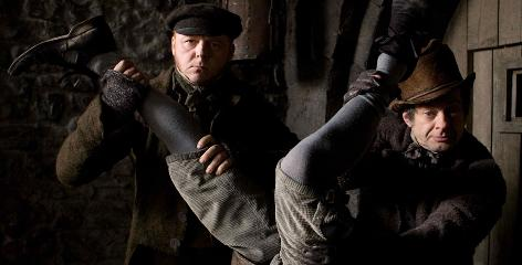 Simon Pegg, left, stars as body snatcher William Burke, with Andy Serkis playing co-snatcher William Hare, in a film set in 1828 Edinburgh, Scotland.