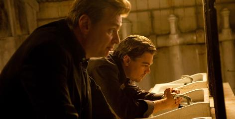 Quiet on the set: Nolan and star Leonardo DiCaprio work on a scene for Inception.
