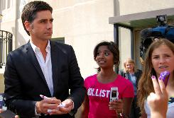 John Stamos meets with fans outside of the federal building in Marquette, Mich., on Tuesday.