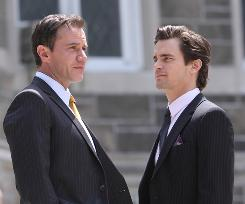 White Collar: Former con man Neal Caffrey (Matt Bomer, right) has gone straight, helping Peter Burke (Tim DeKay), the FBI agent who caught him snag like-minded criminals.