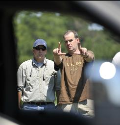 Associate pastor Alex Kendrick, right, sets up a shot with photography director Bob Scott. Courageous is the fourth faith-based movie produced by Sherwood Baptist Church.