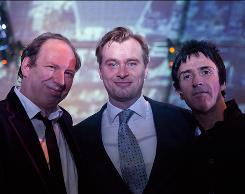 Collaborators: Hans Zimmer, left, and rock guitarist Johnny Marr, right, created the soundtrack for Inception, the latest film from director Christopher Nolan, center.
